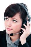 Nette junge Frau mit Kopfhörer Stockfotografie