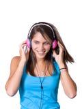 Nette junge Frau mit Kopfhörern Stockbild