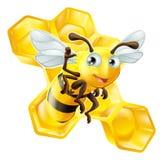 Nette Karikatur-Biene und Bienenwabe Stockfoto
