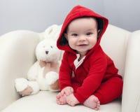 Nette kaukasische Babymädchenblaue augen Stockfotografie