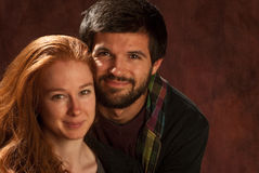 Nette lächelnde Paare Stockfotos