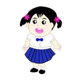 Nette Mädchen, die eine Schuluniform tragen Lizenzfreies Stockfoto