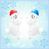 Nette Schneemänner Stockfotografie