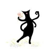 Nette schwarze Katze mit Blumenstrauß Lizenzfreie Stockfotografie