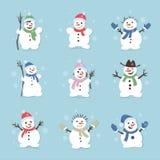 Nette und lustige Schneemänner Weihnachtsillustrationen Gesetzte Ikone des Vektors Lizenzfreie Stockfotografie