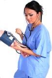 Nette weibliche Krankenschwester, Doktor, medizinische Arbeitskraft stockfoto