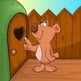 Netter Braunbär, der in die Höhle klopft Lizenzfreie Stockfotografie