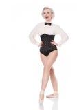 Netter glücklicher junger Tänzer im Korsett und in Fliege, lokalisiert auf Weiß Lizenzfreies Stockfoto