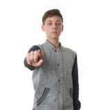 Netter Jugendlichjunge in der grauen Strickjacke über Weiß lokalisierte Hintergrund Lizenzfreies Stockbild