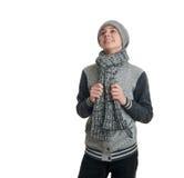 Netter Jugendlichjunge in der grauen Strickjacke über Weiß lokalisierte Hintergrund Lizenzfreie Stockbilder
