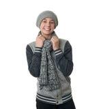 Netter Jugendlichjunge in der grauen Strickjacke über Weiß lokalisierte Hintergrund Lizenzfreies Stockfoto
