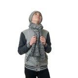 Netter Jugendlichjunge in der grauen Strickjacke über Weiß lokalisierte Hintergrund Stockfotos