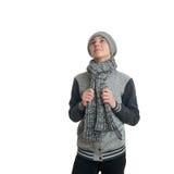 Netter Jugendlichjunge in der grauen Strickjacke über Weiß lokalisierte Hintergrund Stockfotografie