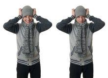 Netter Jugendlichjunge in der grauen Strickjacke über Weiß lokalisierte Hintergrund Stockbilder
