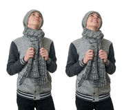 Netter Jugendlichjunge in der grauen Strickjacke über Weiß lokalisierte Hintergrund Stockfoto