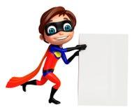 netter Junge als Superheld mit weißem Brett Lizenzfreie Stockbilder