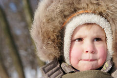 Netter Junge im Snowsuit Lizenzfreie Stockbilder
