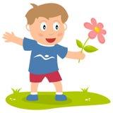 Netter Junge mit Blume Stockfoto