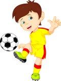 Netter Jungenfußballspieler Stockfotos