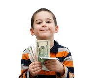 Netter kleiner Junge hält Banknoten an stockfoto
