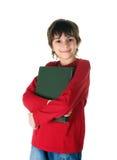 Netter kleiner Junge mit einem großen Buch stockbild