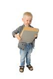 Netter kleiner Junge mit großem Buch Stockfotos