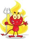 Netter kleiner roter Teufel mit Pitchfork in Front Fire Stockfotos