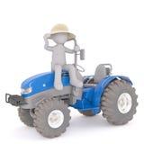 Netter Landwirt 3d, der auf einem blauen Traktor sitzt Stockfotografie