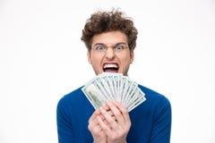 Netter Mann mit den Gläsern, die Geld halten stockfotos