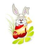 Netter Osterhase mit rotem Ei und goldenem Bogen Stockbilder