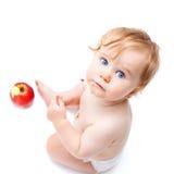 Netter Säuglingsjunge mit Apfel Lizenzfreie Stockfotos