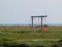 Netter Spielplatz auf dem Strand Stockbilder