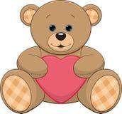 Netter Teddybär mit einem Herzen Stockbild