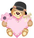 Netter Teddybär mit Herzen Stockbild