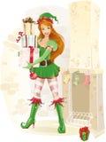 Netter weiblicher Elf mit Weihnachtsgeschenken Stockfotografie