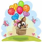 Netter Welpe im Kasten fliegt auf Ballone stock abbildung