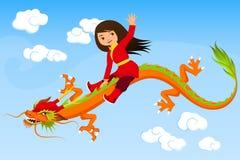 Nettes asiatisches Mädchen, das einen Drachen reitet Lizenzfreie Stockfotografie