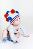 Nettes Baby in einer Strickmütze Lizenzfreie Stockfotografie