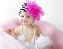 Nettes Baby im Ballettröckchen und im Hut Stockbild