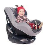 Nettes Baby im Sicherheitsautositz über Weiß Lizenzfreies Stockbild