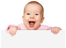 Nettes Baby mit der weißen leeren Fahne lokalisiert Lizenzfreies Stockbild