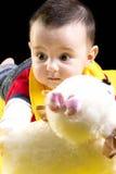 Nettes Baby mit Spielzeug Lizenzfreie Stockbilder