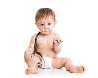Nettes Baby mit Stethoskop in der Hand Stockfotos