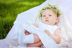 Nettes Baby- und Blumenmaiglöckchen Stockfotos