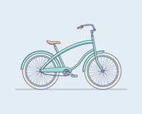 Nettes blaues Fahrrad mit Rädern, Pedale Lizenzfreie Stockfotografie