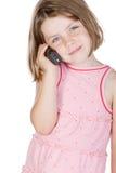 Nettes blondes Kind, das am Telefon spricht Stockfotos