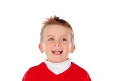 Nettes blondes Kind mit rotem Trikot Lizenzfreie Stockfotos