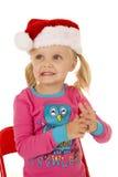 Nettes blondes Mädchen, das Sankt-Hut weg schaut trägt Stockfoto