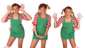 Nettes blondes Mädchen mit Freckles und Gefühle grünen Stockfotografie