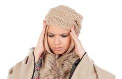 Nettes blondes Mädchen mit Kopfschmerzen Stockbilder